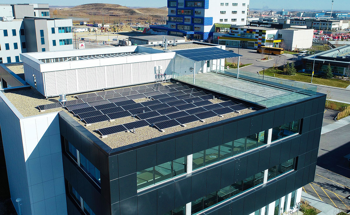 19 kW Ballasted Rooftop with 6 kW Patio Canopy featuring transparent modules